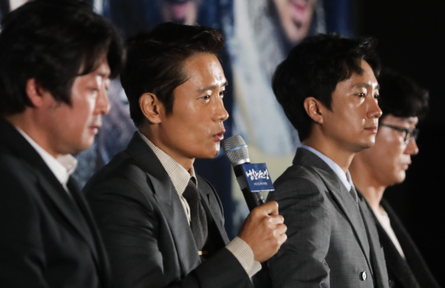 """From left: Kim Yoon-seok, Lee Byung-hun, Park Hae-il and Hwang Dong-hyuk speak to reporters at a press conference for """"The Fortress"""" at CGV Yongsan in Seoul, Monday. (Yonhap)"""