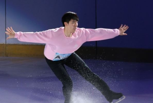 In this file photo taken Aug. 12, 2017, South Korean figure skater Lee June-hyoung performs during an ice show titled