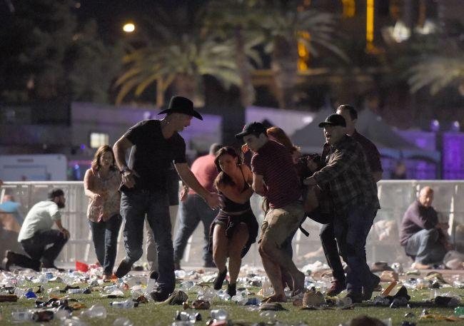 People carry a peson at the Route 91 Harvest country music festival after apparent gun fire was heard on Sunday in Las Vegas, Nevada. (AFP-Yonhap)
