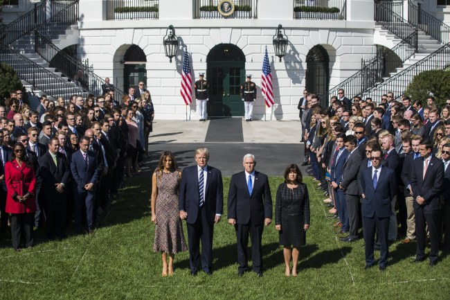 US President Donald J. Trump (C-L) and First Lady Melania Trump (L), along with Vice President Mike Pence (C-R) and and his wife Karen Pence (R), surrounded by staff, hold a moment of silence for the victims of the mass shooting in Las Vegas on the South Portico of the White House in Washington. (EPA-Yonhap)