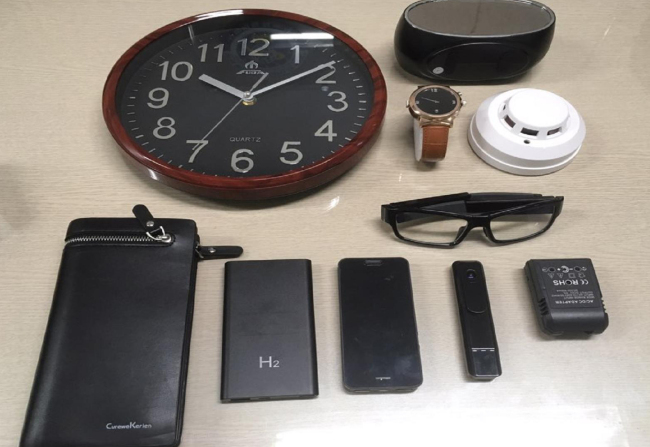 Confiscated cameras that were smuggled into the country are designed to resemble ordinary objects, making them difficult to detect. (Yonhap)