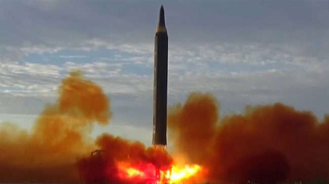 A North Korean intermediate range ballistic missile is seen taking off in a photograph released by Pyongyang`s state-run media on Sept. 16. Yonhap