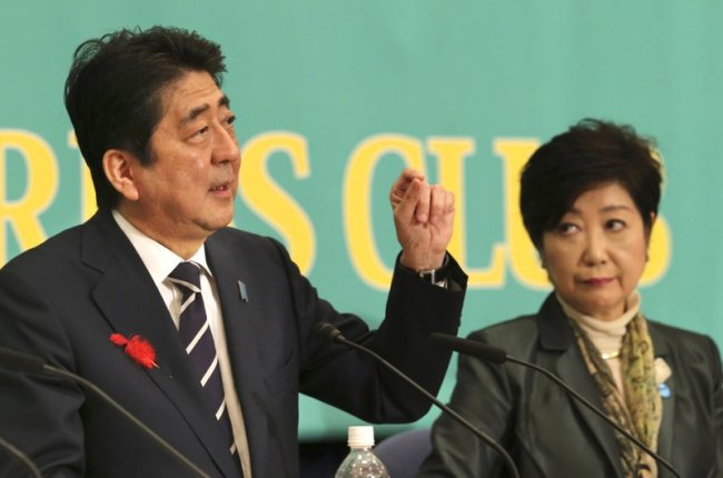 Ruling Liberal Democratic Party leader and Japan's Prime Minister Shinzo Abe, left, speaks as Party of Hope leader Yuriko Koike, listens during their debate for the Oct. 22 lower house election in Tokyo, Sunday, Oct. 8, 2017. (AP)