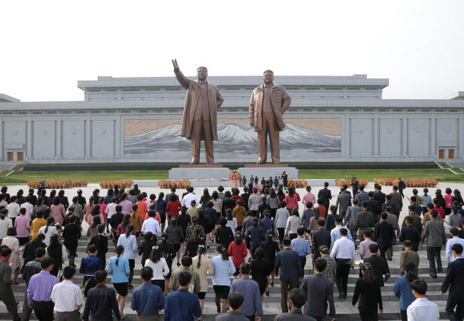 North Korean residents gather at the statue of the North late leader Kim Il-sung and his son Kim Jong-il. Yonhap