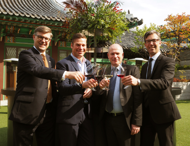 Representatives of South Australian wineries, including Brian Smedley, chief executive of the South Australian Wine Industry Association (second right), pose at the South Australian Food and Wine Showcase at Hotel Shilla in Seoul on Friday. (Joel Lee/The Korea Herald)