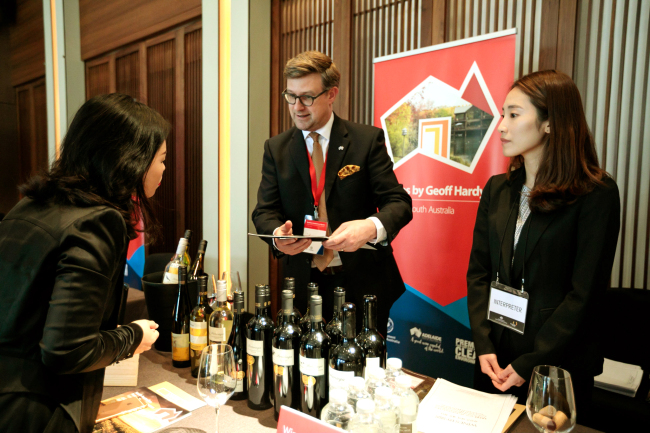 A guest looks for information on South Australian wine at the South Australian Food and Wine Showcase at Hotel Shilla in Seoul on Friday (Austrade in Korea)