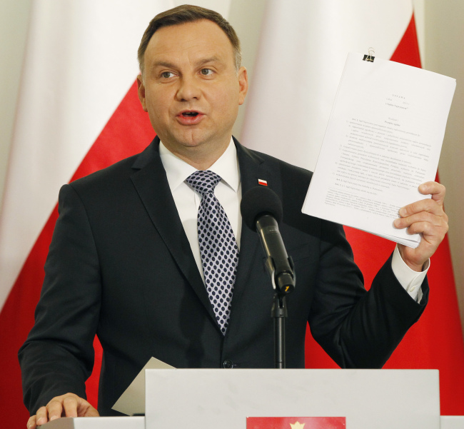 Poland's President Andrzej Duda announces his proposals for reorganizing the Supreme Court and a top judicial body at the Presidential Palace in Warsaw, Poland, Monday, Sept. 25, 2017. Poland's most powerful politician, ruling party leader Jaroslaw Kaczynski says they vary on the proposals. (AP Photo/Czarek Sokolowski)