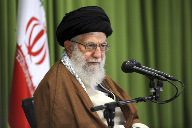 In this photo released by an official website of the office of the Iranian supreme leader, Supreme Leader Ayatollah Ali Khamenei speaks at a meeting in Tehran, Iran, Wednesday, Oct. 18, 2017. Khamenei on Wednesday urged Europe to do more to back the 2015 nuclear deal after President Donald Trump refused to re-certify the pact and European companies have rushed into the Iranian markets since the landmark accord. (Office of the Iranian Supreme Leader via AP)