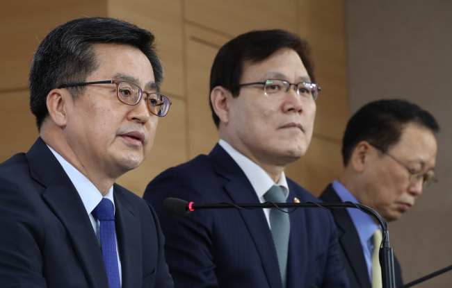 Deputy Prime Minister and Finance Minister Kim Dong-yeon (left) speaks in a press briefing on the government's comprehensive measures on household debt management. (Yonhap)