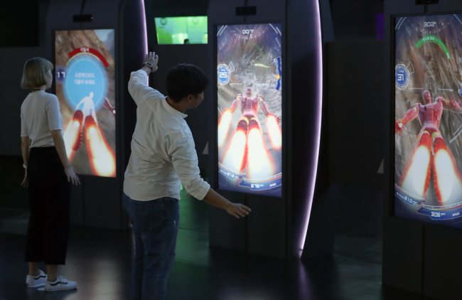 ASIA'S FIRST MARVEL EXPERIENCE CENTER - Visitors to Marvel Experience, a mobile interactive attraction featuring Marvel's flagship characters including Thor, Iron Man and Spider-Man, experience the facility's offerings Thursday. The new facility is located in Busan and is the first of its kind to open in Asia. (Yonhap)