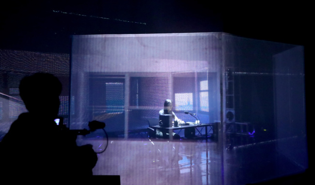 """Team """"Atmo: Generative Music for Spatial Atmosphere"""" showcases its works for an AI project organized by Korea Creative Content Agency and S.M. Entertainment on Wednesday in Seoul. (Yonhap)"""