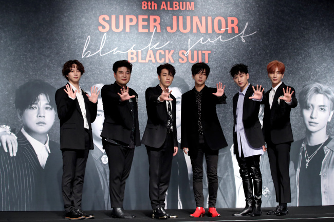 """Six members of K-pop act Super Junior pose during a press conference for the group's new album """"Play,"""" in Seoul on Monday. Choi Si-won has not been participating in the group's recent promotions. (Yonhap)"""
