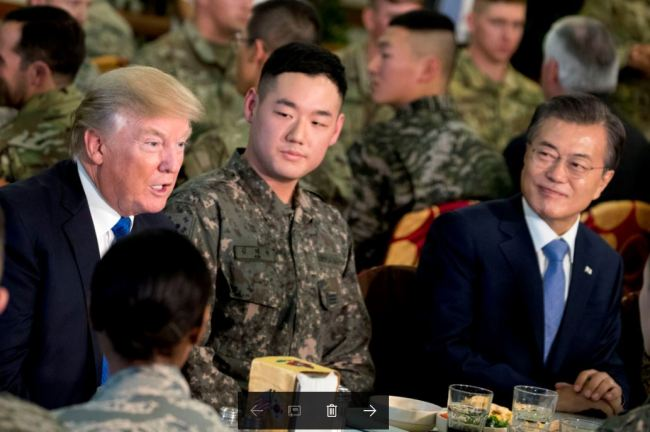 South Korean President Moon Jae-in and US President Donald Trump at Camp Humphreys (AP-Yonhap)