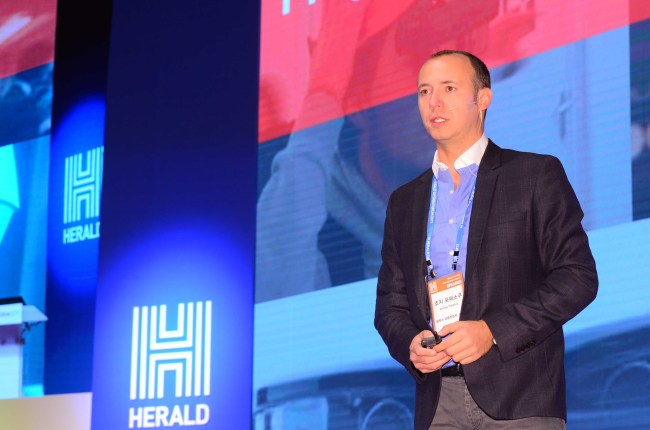George Popescu speaks at The Herald Design Forum at The Shilla Seoul on Tuesday. (Lee Sang-sub/The Korea Herald)