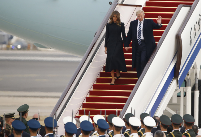 US President Donald Trump and first lady Melania Trump arrive in Beijing on Wednesday. (Yonhap)