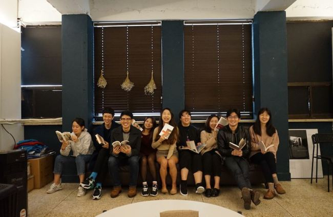 Trevari staff members pose for pictures in the company's office in Apgujeong-dong, Seoul. (Trevari)