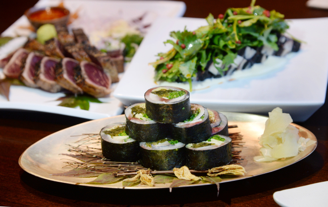 Romantei's isobe maki (front), octopus terrine (right, back), katsuo tataki (left, back) is seared over a straw fire and served with slices of garlic in a nod to the tradition of Tosa cuisine. (Photo credit: Park Hyun-koo/The Korea Herald)