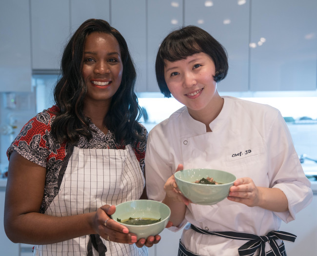A cooking class participant (left) and chef Lee Min-jung, CEO of I Love Hansik, pose for a photo after a class at the company's Yeonnam-dong studio on Nov. 7. (I Love Hansik)