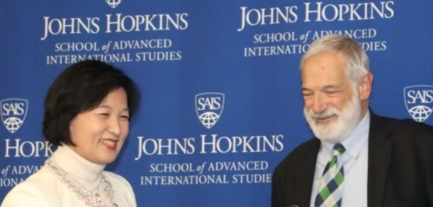 Robert Gallucci, head of the U.S.-Korea Institute at the Johns Hopkins School of Advanced International Studies, smiles with Choo Mi-ae, leader of South Korea`s ruling Democratic Party, at a forum held at the think tank in Washington on Nov. 15, 2017. (Yonhap)
