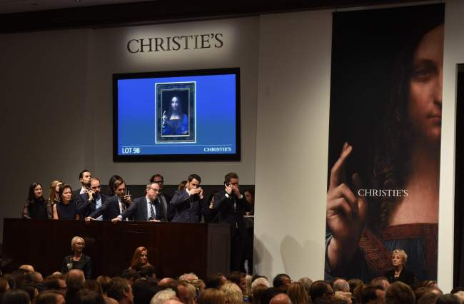 "Christie's employees take bids for Leonardo da Vinci's ""Salvator Mundi"" during the Post-War & Contemporary Art Evening Sale at Christie's New York on Wednesday. (AFP-Yonhap)"