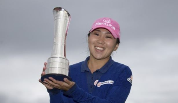 In this Associated Press file photo taken Aug. 6, 2017, Kim In-kyung of South Korea celebrates with the champion`s trophy after winning the Ricoh Women`s British Open at Kingsbarns Golf Links in Fife, Scotland. (Yonhap)