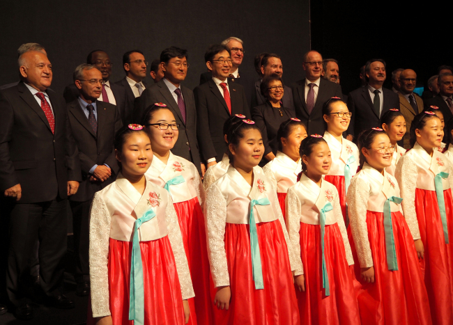 Incheon Seo-gu Girls and Boys Choir performs at the Latvian National Day reception on Friday. (Joel Lee/The Korea Herald)