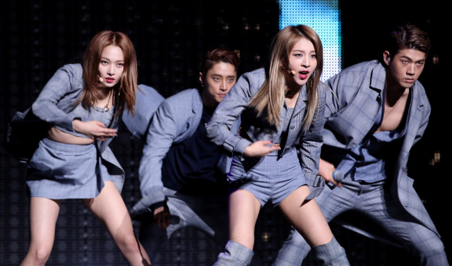 """K.A.R.D performs during a media showcase for its new EP """"You & Me"""" in Seoul on Tuesday. (Yonhap)"""