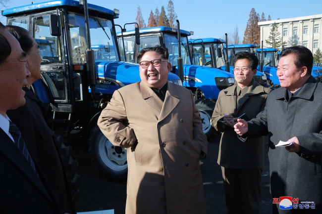 North Korean leader Kim Jong-un inspects a tractor factory in November. (Korea Central News Agency)