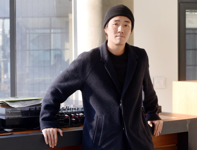 Music video director Kim Sung-wook poses prior to an interview at his studio in Hannam-dong, Seoul, Monday. (Park Hyun-koo / Korea Herald)