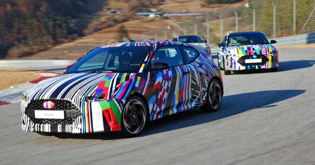 The camouflaged second-generation Veloster hatchback is seen at a media preview event at a race track in Gangwon Province earlier this week. (Hyundai Motor)