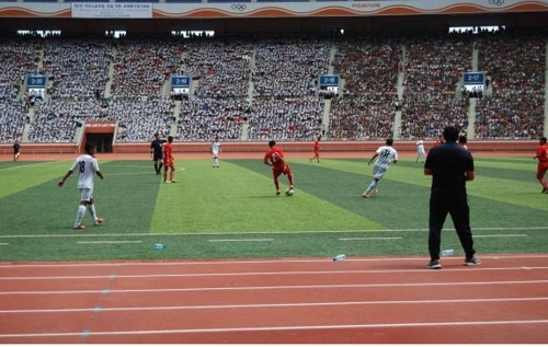 This photo provided by the Gangwon Provincial Government shows a youth football match at the Rungrado 1st of May Stadium in Pyongyang on Aug. 22, 2015. (Yonhap)