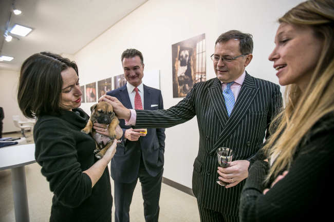 British Ambassador Charles Hay (second from right) poses with a puppy rescued from a dog farm in Korea by Humane Society International at a photo exhibition in Seoul on Thursday. In the picture are his spouse Pascale (left), businessman and environmentalist Robin Russell (second from left) and HSI campaign manager Lola Webber. (Humane Society International)