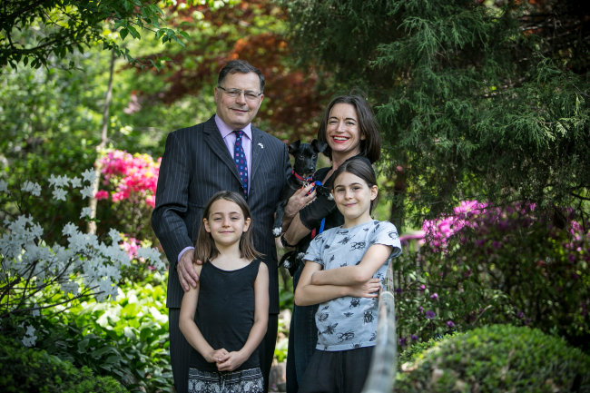 British Ambassador to Korea Charles Hay poses with his spouse Pascale, daughters and Caspian, rescued from a dog farm in Korea in 2016. (Humane Society International)