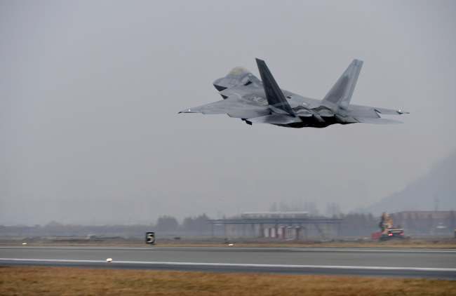 F-22 Raptors takes off from South Korea`s air base in Gwangju. Yonhap