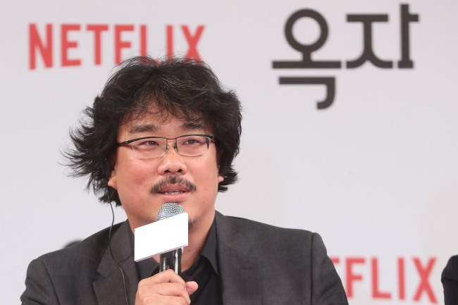 Director Bong Joon-ho speaks at a press conference in Seoul in May. (Yonhap)