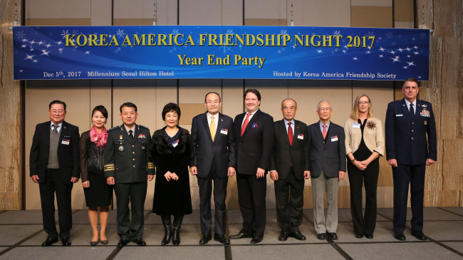 Members of the Korea America Friendship Society post at the annual year-end reception at Millennium Seoul Hilton on Dec. 5. (Korea America Friendship Society)