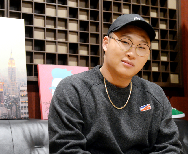 Rapper Swings poses during a recent interview with The Korea Herald in Seoul. (Park Hyun-koo / Korea Herald)