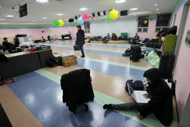 College students at a college in Pohang evacuated to a nearby church after the quake (Yonhap)