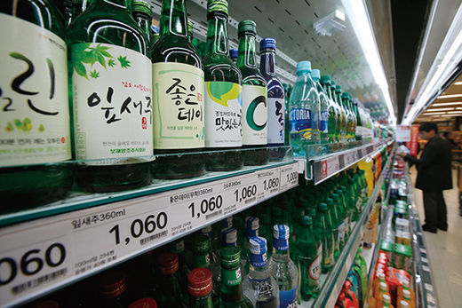 Bottles of soju are displayed at a store. Yonhap