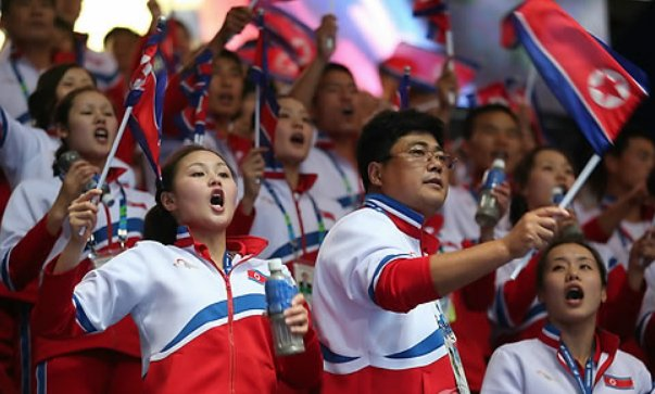 This file photo taken on Sept. 27, 2014, shows North Koreans supporting their athletes in the men`s wrestling competition at the Asian Games in Incheon. (Yonhap)