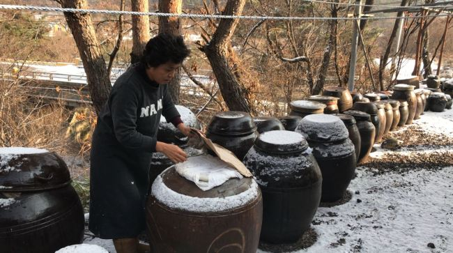 Airbnb host Yoon In-sook at her clay house