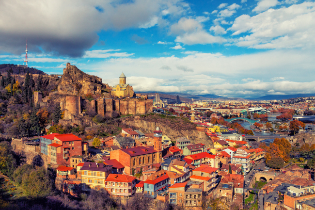 Georgian capital Tbilisi, a city with more than 1,500 years of history, is laden with medieval fortresses, cobbled winding alleys, timeworn, magnificent religious edifices, saunas and spas. (AP/Yonhap)