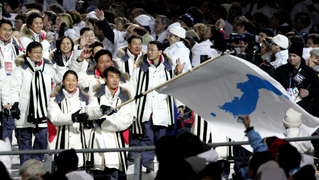 The two Koreas' delegates marched together under the Korean unification flag during opening ceremony of 2006 Torino Winter Olympics Games. Yonhap