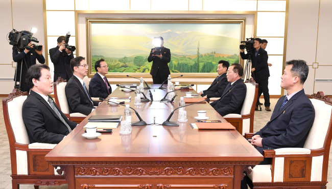 This photo, provided by Seoul`s Unification Ministry on Wednesday, shows working-level talks between the two Koreas on the North`s participation in the PyeongChang Winter Olympics. (Yonhap)