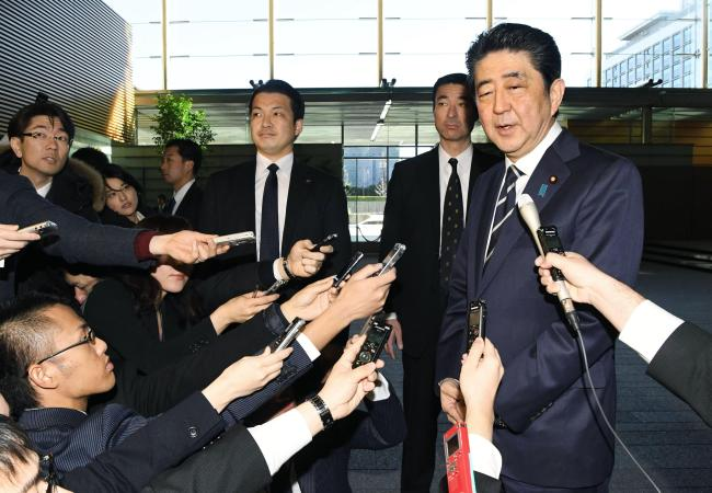 Japanese Prime Minister Shinzo Abe speaks to members of the press in Tokyon on Wednesday. Yonhap
