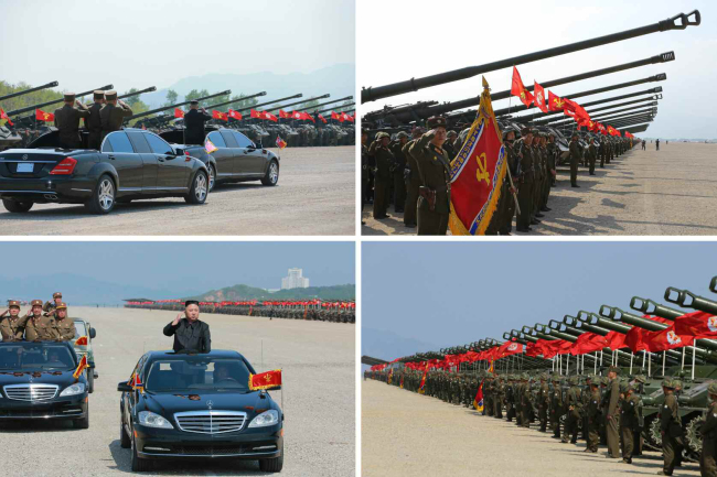 This file photo shows North Korean leader Kim Jong-un inspecting artillery units attending a military parade to celebrate the 58th anniversary of the country's founding of the People's Army in April last year. (Yonhap)