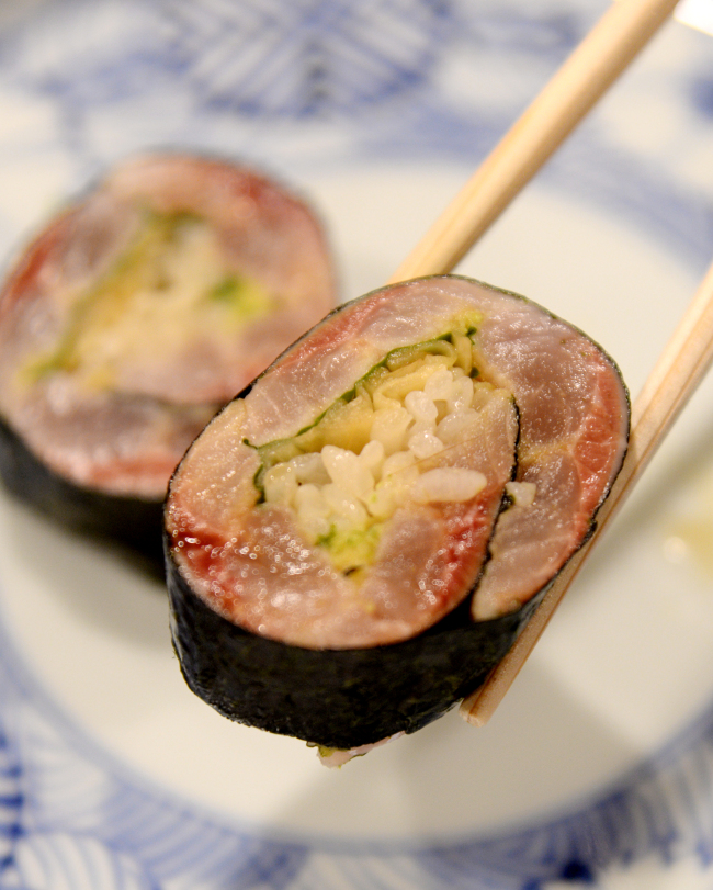 Sushi Shimizu's isobe maki is crafted from herring, sushi rice, shiso, in-house pickled ginger, wasabi and dried laver. (Park Hyun-koo/The Korea Herald)