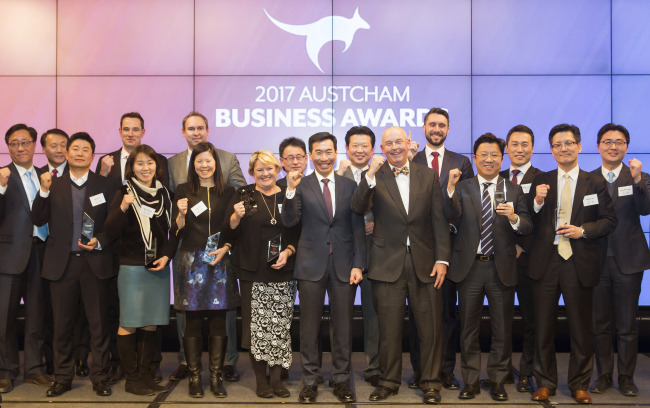 Participants pose at the AustCham Korea's Business Awards Night in Seoul on Friday. In the picture are Australian Ambassador to Korea James Choi (center) and AustCham Chairman Graham Dodds (front, third from right). (Australian Chamber of Commerce in Korea)