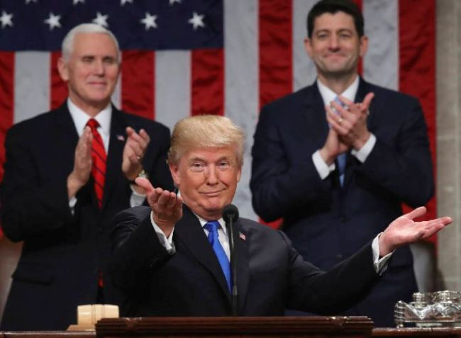 President Donald Trump gestures as delivers his first State of the Union address in the House chamber of the U.S. Capitol to a joint session of Congress Tuesday, Jan. 30, 2018 in Washington, as Vice President Mike Pence and House Speaker Paul Ryan applaud. (AP)