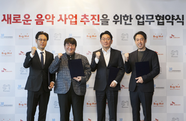 (From left) Jung Wook, CEO of JYP Entertainment, Bang Si-hyuk, CEO of Big Hit Entertainment, Noh Jong-won, head of SK Telecom's Unicorn Labs and Kim Young-min, CEO of S.M. Entertainment, attend an event announcing their joint music service project at SK Telecom's headquarters in Seoul on Wednesday. (SK Telecom)